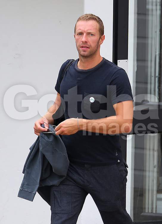 Coldplay frontman Chris Martin, who is rumored to be dating American actress Jennifer Lawrence, spotted leaving a gym in London, UK. 05/09/2014 <br />