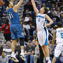 February 1, 2011; New Orleans, LA, USA; Washington Wizards power forward Yi Jianlian (31) shoots over New Orleans Hornets center David Andersen (11) during the second quarter at the New Orleans Arena.   Mandatory Credit: Derick E. Hingle
