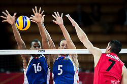 10.09.2014, Centennial Hall, Breslau, POL, FIVB WM, Kuba vs Kanada, 2. Runde, Gruppe F, im Bild Isbel Mesa Sandoval cuba #16 Leandro Macias Infante cuba #5 Dallas Soonias canada #7 // Isbel Mesa Sandoval cuba #16 Leandro Macias Infante cuba #5 Dallas Soonias canada #7 during the FIVB Volleyball Men's World Championships 2nd Round Pool F Match beween Cuba and Canada at the Centennial Hall in Breslau, Poland on 2014/09/10. EXPA Pictures © 2014, PhotoCredit: EXPA/ Newspix/ Sebastian Borowski<br /> <br /> *****ATTENTION - for AUT, SLO, CRO, SRB, BIH, MAZ, TUR, SUI, SWE only*****