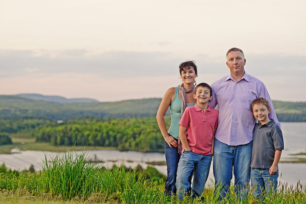 Maine family portrait session in front of the lake.  Image by Maine Wedding Photographer, Puerto Vallarta Wedding Photographer, New York City Wedding Photographer and Philadelphia Wedding Photographer Michelle Turner.