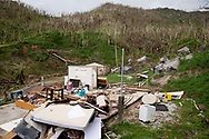 MAUNABO, PUERTO RICO - OCTOBER 9, 2017 -  View of Betzaida Negron&rsquo;s demolished house in Tumbao, Naguabo, where the center of Hurricane Maria cause some of the most extensive damage. Betzaida has been living here for the past thirty years and now plans to move to Kissimmee, Florida. (Photo/Jos&eacute; Jim&eacute;nez) Through the Iris of Hurricane Mar&iacute;a<br />