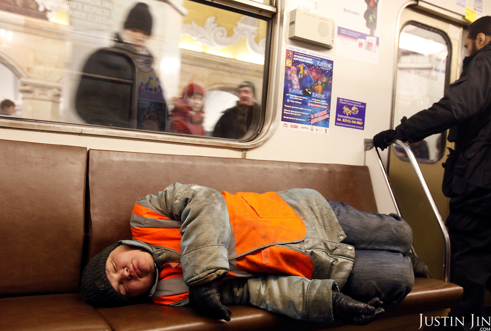 A man sleeps on the train on the  Moscow ring line. The ring line is a common hangout for the homeless because the train goes round and round without reaching a terminal. .The Moscow Metro, which spans almost the entire Russian capital, is the world's second most heavily used metro system after the Tokyo's twin subway. Opened in 1935, it is well known for the ornate design of many of its stations, which contain outstanding examples of socialist realist art.