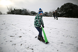 © Licensed to London News Pictures. 17/01/2016. Dorking, UK. A boys uses a snow scooter on the slopes of Box Hill. Snow has fallen in the South East for the first time this winter. Photo credit: Peter Macdiarmid/LNP