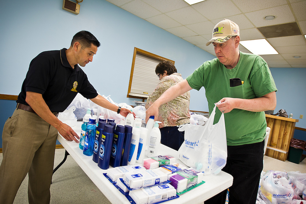 Volunteers at the American Legion Post 201 in Tomah, Wisc, pack toiletries and necessities on Tuesday, June 23 for an upcoming outreach effort through an Operation Comfort Warriors grant. Photo by Ben Brewer.