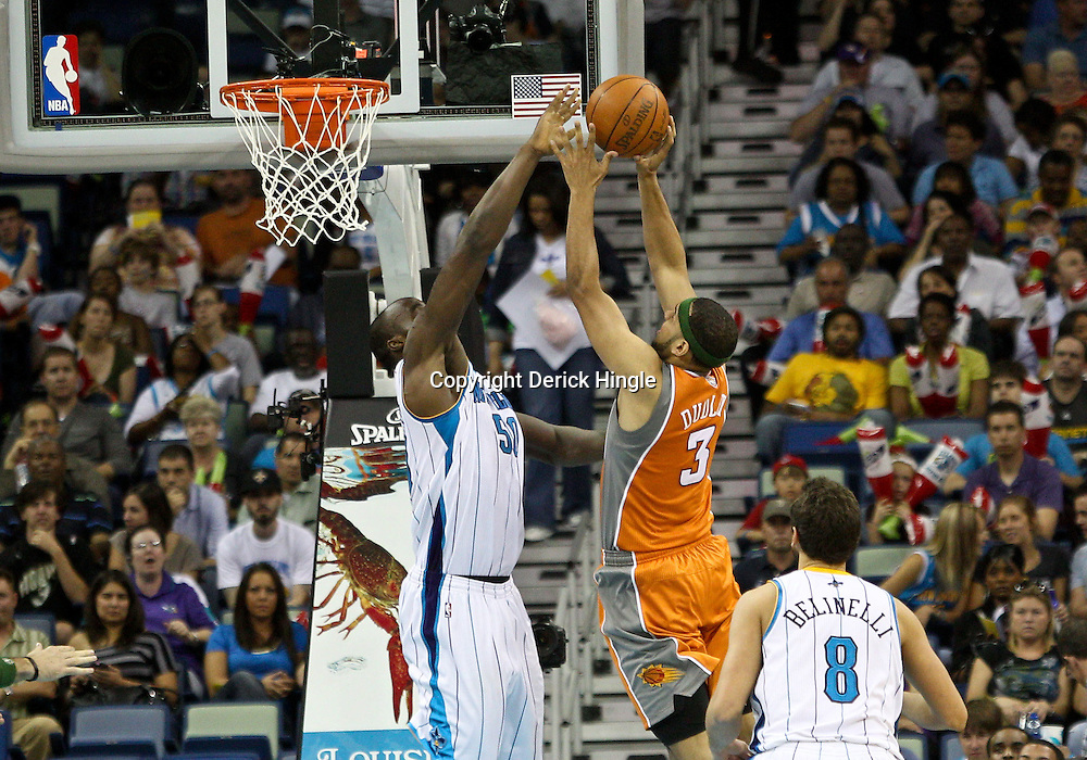 April 8, 2011; New Orleans, LA, USA; New Orleans Hornets center Emeka Okafor (50) blocks a shot by Phoenix Suns small forward Jared Dudley (3) during the second quarter at the New Orleans Arena.  Mandatory Credit: Derick E. Hingle