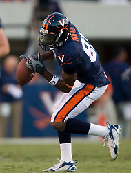 Virginia wide receiver Dontrelle Inman (81) brings in a pass from Virginia quarterback Jameel Sewell (10)..The Virginia Cavaliers defeated the Connecticut Huskies 17-16 at Scott Stadium in Charlottesville, VA on October 13, 2007