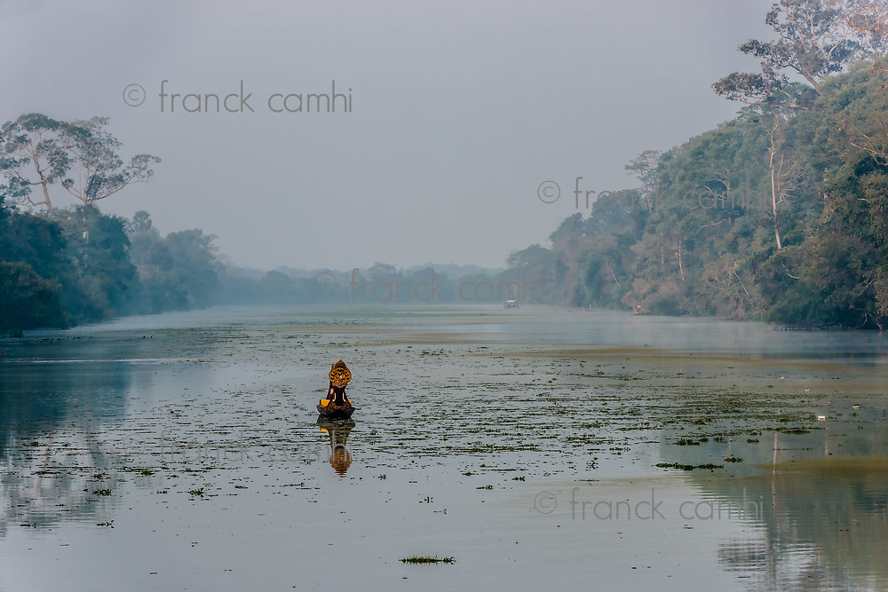 boat in the moat by the south gate bridge Angkor Thom Cambodia