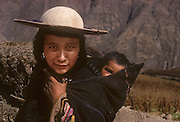 South America, Bolivia. Quecha Indian woman and baby in a hamlet of Ayata, Departamento La Paz, Provincia Munecas.