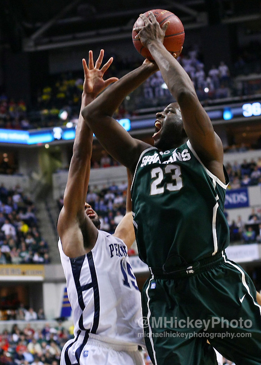 March 12, 2011; Indianapolis, IN, USA; Michigan State Spartans forward Draymond Green (23) shoots over Penn State Nittany Lions forward David Jackson (15) in the semi-final round of the 2011 Big Ten Tournament at Conseco Fieldhouse. Penn State defeated Michigan State 61-48. Mandatory credit: Michael Hickey-US PRESSWIRE