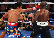 LAS VEGAS, NV - JUNE 09:  (L-R) Manny Pacquiao lands a right to the head of Timothy Bradley during their WBO welterweight title fight at MGM Grand Garden Arena on June 9, 2012 in Las Vegas, Nevada.  (Photo by Jeff Bottari/Getty Images)