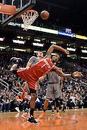 Feb 4, 2016; Phoenix, AZ, USA;  Houston Rockets forward Trevor Ariza (1) looses balance while driving the ball against the Phoenix Suns at Talking Stick Resort Arena. The Rockets won 111 - 105. Mandatory Credit: Jennifer Stewart-USA TODAY Sports