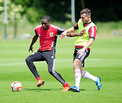 Bristol City's Jordan Wynter shields the ball from Mitch Brundle  - Photo mandatory by-line: Dougie Allward/JMP - Tel: Mobile: 07966 386802 28/06/2013 - SPORT - FOOTBALL - Bristol -  Bristol City - Pre Season Training - Npower League One