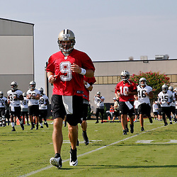 Jul 26, 2013; Metairie, LA, USA; New Orleans Saints quarterback Drew Brees (9) with teammates during the first day of training camp at the team facility. Mandatory Credit: Derick E. Hingle-USA TODAY Sports