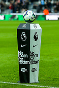 The ball sits on a pedestal displaying 'Kick It Out' campaign branding highlight the motto 'No room for racism' ahead of the Premier League match between Newcastle United and Crystal Palace at St. James's Park, Newcastle, England on 6 April 2019.