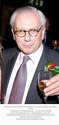 Historian DAVID STARKEY at a party in London on 23rd April 2003.PIY 8