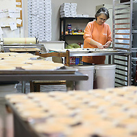 Lauren Wood | Buy at photos.djournal.com<br /> Judy Holder, store manager, lays out mini pie shells on a cookie sheet to make sweet potato pecan pie at Sweet Potato Sweets in Vardaman. The sweet potato pie and the sweet potato pecan pie are two of the store's best sellers, and can be shipped across the country.