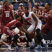 Jesse Morgan, (left), Temple, challenges for a loose ball with Markus Kennedy, SMU, during the Temple Vs SMU Semi Final game at the American Athletic Conference Men's College Basketball Championships 2015 at the XL Center, Hartford, Connecticut, USA. 14th March 2015. Photo Tim Clayton