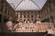 Shadows fall onto the interior of the Louvre, May 20, 1997 in Paris, France, as tourists walk through the museum.  (photo by William Thomas Cain)