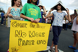 04 June 2012. New Orleans, Louisiana,  USA. .L/R; Ella Rose Huck (9 yrs), Quinn Russell (9 yrs) and Talia Altman (9 yrs) join local citizens gathered to show their support for a 7 day newspaper in the city following the recent shock announcement that the Times Picayune, having survived 175 years and Hurricane Katrina is to be decimated by Advance Publications Inc, a Newhouse family company. Staff were shocked when the New York Times broke the story. The paper, with the highest readership rate in the USA is to have print days cut to just 3 days a week, Wednesday, Friday and Sunday starting this autumn. Despite the newspapers' relative success, (it is still in the black) having undergone swathes of recent cuts, Advance Publications Inc has decided to make further cuts and roll out an expanded digital version of the newspaper via its enhanced web presence at NOLA.com. Advance Publications has stripped print runs from Alabama newspapers and continues to look to slash print runs throughout its empire. This will be the first major US city to not have a daily newspaper..Photo; Charlie Varley.