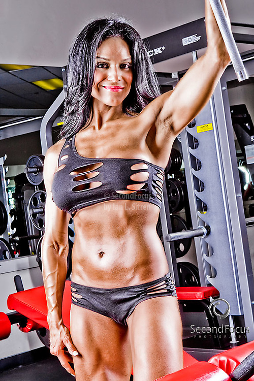 Fitness model Angela Segovia working out at the Power of Fitness Gym.