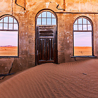 The desert reclaims an abandoned mining town in Kolmanskop.