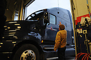 Assistant General Manager Bill Farntz waves hello to a new customer as another rig pulls into the TA Travel Centers of America service bays in Morris, Illinois.