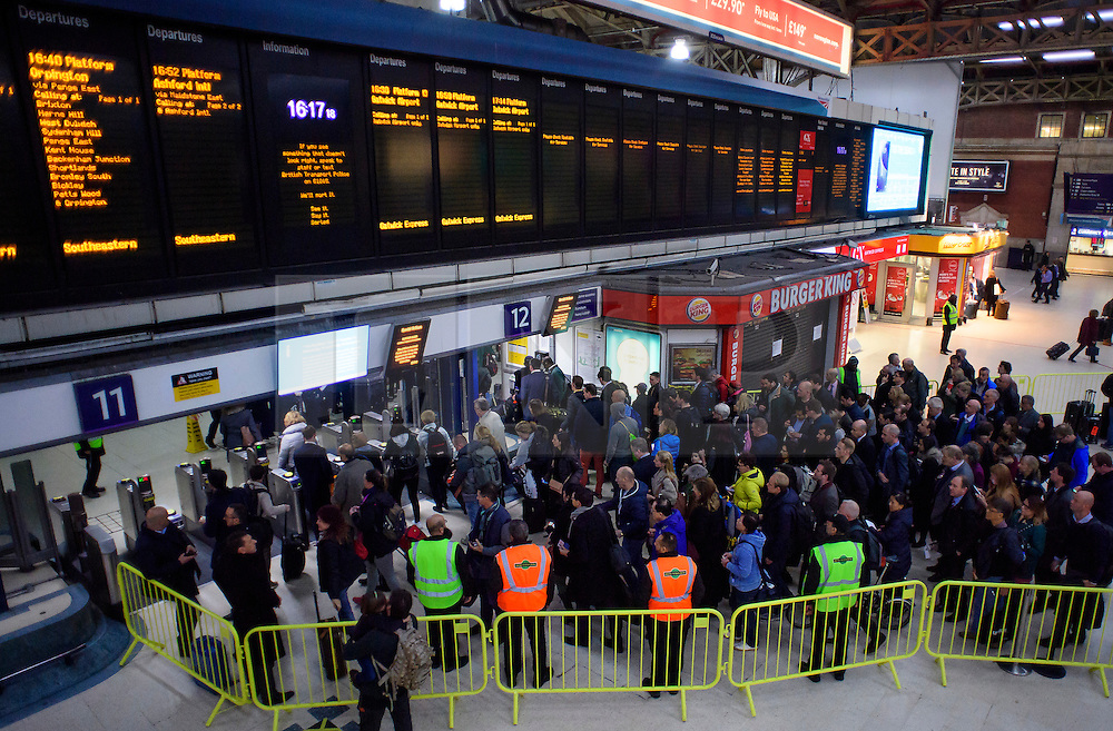 © Licensed to London News Pictures. 14/12/2016. London, UK. Members of the public queue in the hope of getting a Southern Rail Gatwick Express train at afternoon rush hour at Victoria Station on 14 December 2016. Hundreds of thousands of rail passengers face a second day of a 3 day all-out strike in an escalating dispute over the role of conductors between Southern Rail and the RMT Union. Photo credit: Ben Cawthra/LNP