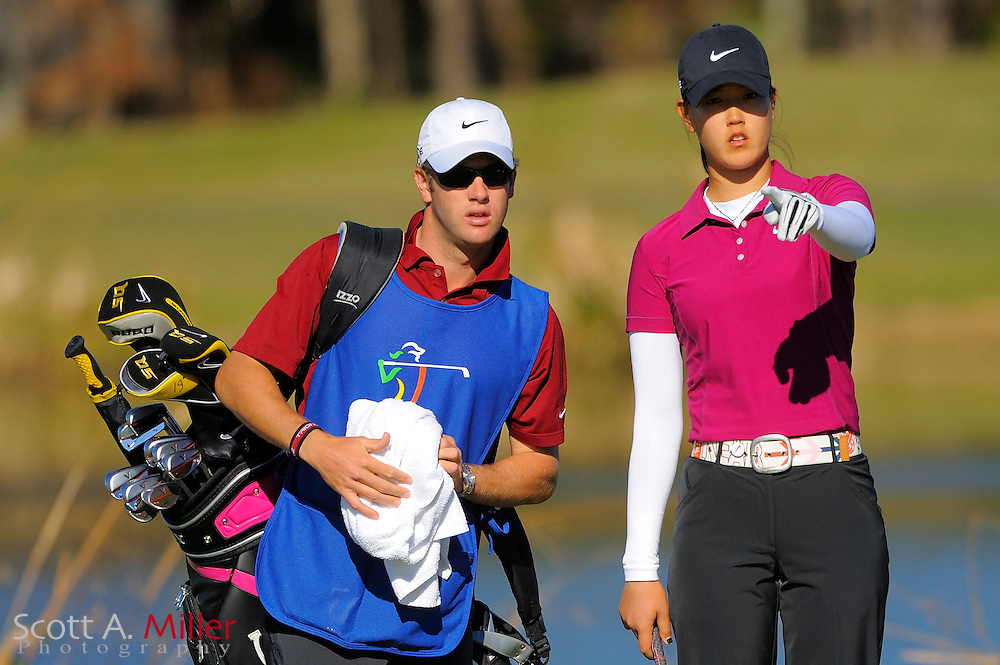Dec. 7, 2008; Daytona, FL, USA; Michelle Wie and her caddie Tim Vickers on the 17th hole during the final round of LPGA Qualifying School on the Champions Course at LPGA International. ...©2008 Scott A. Miller