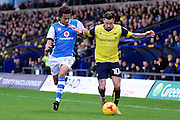 Oxford United striker Chris Maguire (10) battles for possession with Walsall defender Kory Roberts (24) during the EFL Sky Bet League 1 match between Oxford United and Walsall at the Kassam Stadium, Oxford, England on 31 December 2016. Photo by Dennis Goodwin.