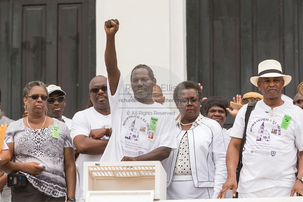 Family members of the Charleston Nine release stand in unity during a memorial service at the Mother Emanuel African Methodist Episcopal Church on the anniversary of the mass shooting June 18, 2016 in Charleston, South Carolina. Nine members of the church community were gunned down during bible study inside the church on June 17, 2015.