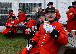 © Licensed to London News Pictures. 21/05/2012. Chelsea, UK . Chelsea Pensioners enjoy a break after a photocell at the show. Press preview of The Chelsea Flower Show today 21 May 2012. The world's most famous flower show, which has been held in the grounds of the Royal Chelsea Hospital since 1913, will be open to the public from Tuesday. Visitors are expected to flock in their thousands to see displays of plants, flowers and furniture for ideas on how to decorate their gardens.. Photo credit : Stephen Simpson/LNP
