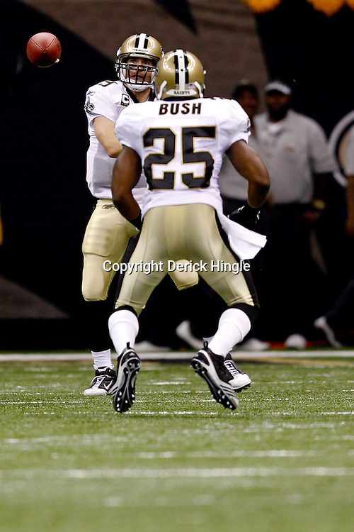 September 9, 2010; New Orleans, LA, USA; New Orleans Saints quarterback Drew Brees (9) throws to running back Reggie Bush (25) during the NFL Kickoff season opener at the Louisiana Superdome. The New Orleans Saints defeated the Minnesota Vikings 14-9.  Mandatory Credit: Derick E. Hingle