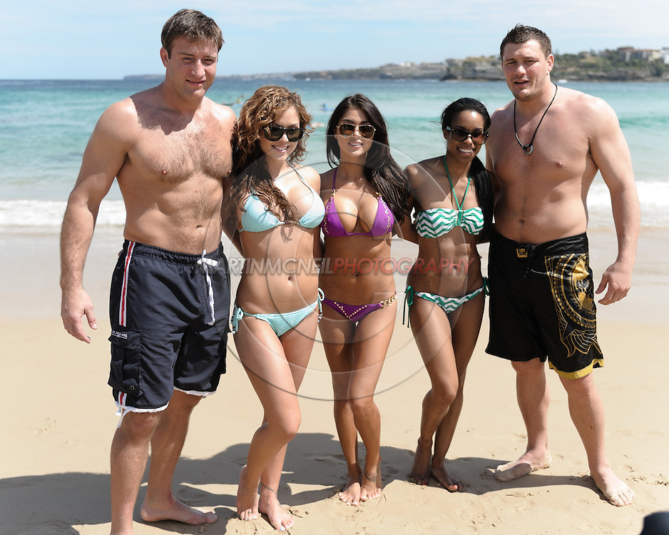 SYDNEY, AUSTRALIA, FEBRUARY 25, 2011: (L to R) Stephan Bonnar, Brittney Palmer, Arianny Celeste, Chandella Powell and Matt Mitrione pose for a photograh on Bondi Beach in Sydney, Australia on February 25, 2011.