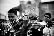 A mariachi plays in the violin in Boyle Heights in Los Angeles, California