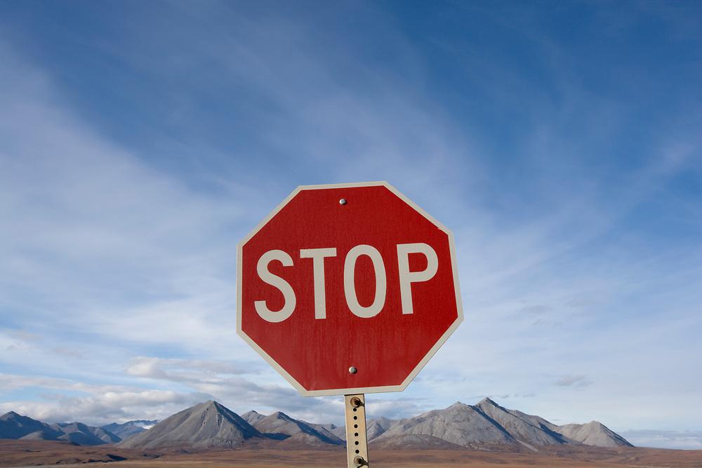 USA, Alaska, Stop sign along Dalton Highway in Brooks Range near Atigun Pass