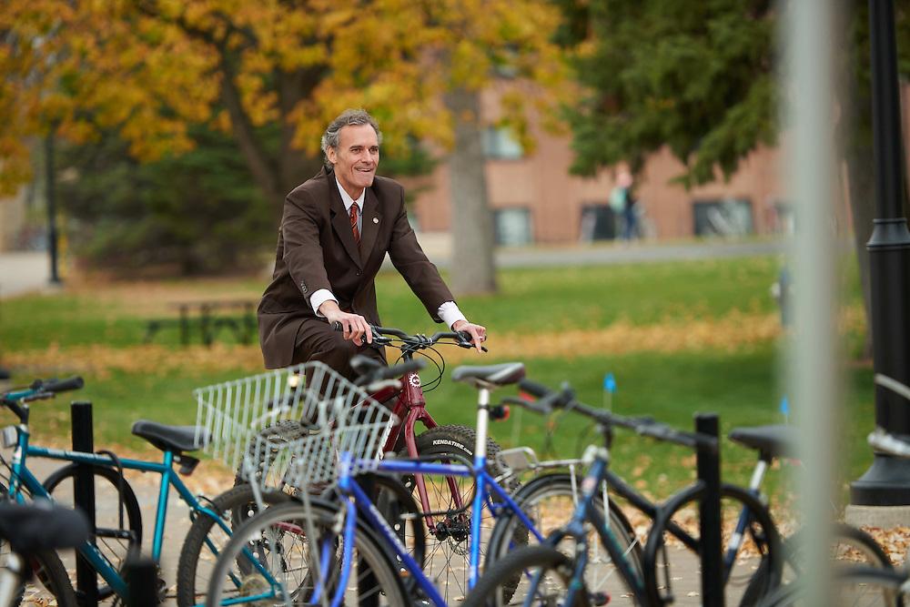 "Bike; Biking; Candid; Chancellor Joe Gow; cloudy; Club; day; Daytime; Fall; Group; Man men; November; Outside; ""Recreational Eagle Center; REC""; Speaking; Student students; Woman women"