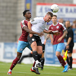 TELFORD COPYRIGHT MIKE SHERIDAN Steph Morley of Telford wins an aerial battle against Josh Kayode of Gateshead during the National League North fixture between AFC Telford United and Gateshead FC at the New Bucks Head Stadium on Saturday, August 10, 2019<br /> <br /> Picture credit: Mike Sheridan<br /> <br /> MS201920-005
