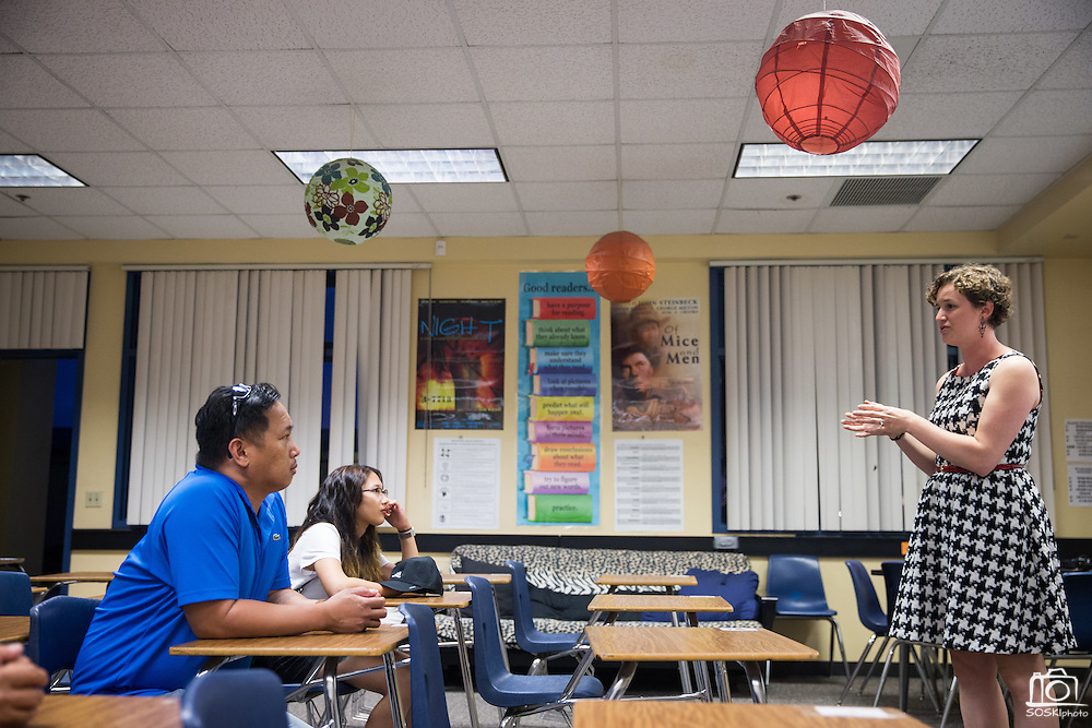 English and ELD teacher Lindsay Gutierrez talks with parents during Back To School Night at Milpitas High School in Milpitas, California, on August 30, 2016. (Stan Olszewski/SOSKIphoto)