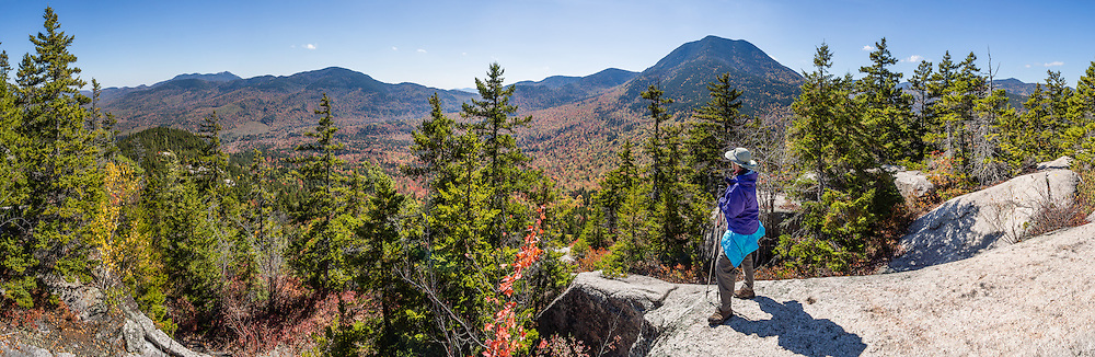 """For views of fall leaf colors and Mount Passaconaway (4043 ft) in White Mountain National Forest, hike the rocky UNH Loop Trail (4.8 miles) on Hedgehog Mountain in the Sandwich Range Wilderness in New Hampshire, USA. The peak intensity of autumn foliage color here is around the first week of October. Find the trailhead parking area marked """"Downes Brook - UNH - Mt. Potash Trails"""" along Kancamagus Highway (NH Route 112) across from Passaconaway Campground and Passaconaway Historic Site. The White Mountains (a range in the northern Appalachians) cover a quarter of the state of New Hampshire. The panorama was stitched from 13 overlapping photos."""