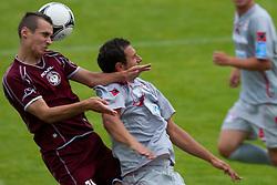Sustersic Martin of NK Triglav vs Kmetec Marko of Aluminij during football match between NK Triglav Kranj and Aluminij 2nd Round of Prva Liga, on 22 July, 2012, in Sportni center, Kranj, Slovenia. (Photo by Grega Valancic / Sportida)