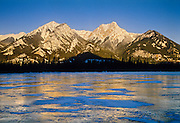 Jasper Lake in early morning light and Canadian Rocky Mountains<br /> Jasper National Park<br /> Alberta<br /> Canada