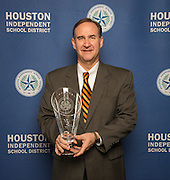IPAA President & CEO Barry Russell poses with a Hall of Fame trophy following the Houston ISD Partnership Appreciation breakfast at Kingdom Builders, October 25, 2013.