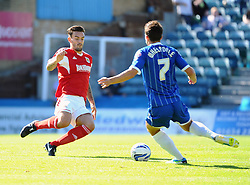 Bristol City's Marlon Pack goes into a challenge with Gillingham's Chris Whelpdale  - Photo mandatory by-line: Seb Daly/JMP - Tel: Mobile: 07966 386802 31/08/2013 - SPORT - FOOTBALL -  Priestfield Stadium - Gillingham - Gillingham Town V Bristol City - Sky Bet League One
