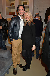 JAMES EDEN and his wife KATIE at the launch of the Private White VC flagship store, 73 Duke Street, London on 11th December 2014.