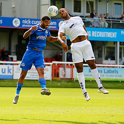 Dovers defender Kevin Lokko and Eastleighs defender Alex Wynter vie for the ball during the National League match between Dover Athletic FC and Eastleigh FC at Crabble Stadium, Kent on 25 August 2018. Photo by Matt Bristow.