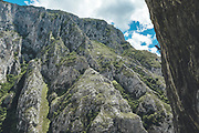 Silhouette of a climber climbing on a overhanging limestone wall Mamut climbing athlete Bobbi Bensman enjoying a climbing trip at Roca Verde, Asturias, Spain