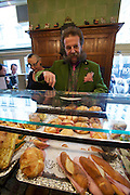 Vienna. Zum schwarzen Kameel. MaÎtre Johann Georg Gensbichler and Erna Lenhardt at the sandwich counter.
