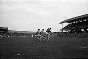 16/10/1966<br /> 10/16/1966<br /> 16 October 1966<br /> Oireachtas Minor Final: Cork v Wexford at Croke Park, Dublin. <br /> Cork's right full-forward sends the ball towards the Wexford goalmouth.