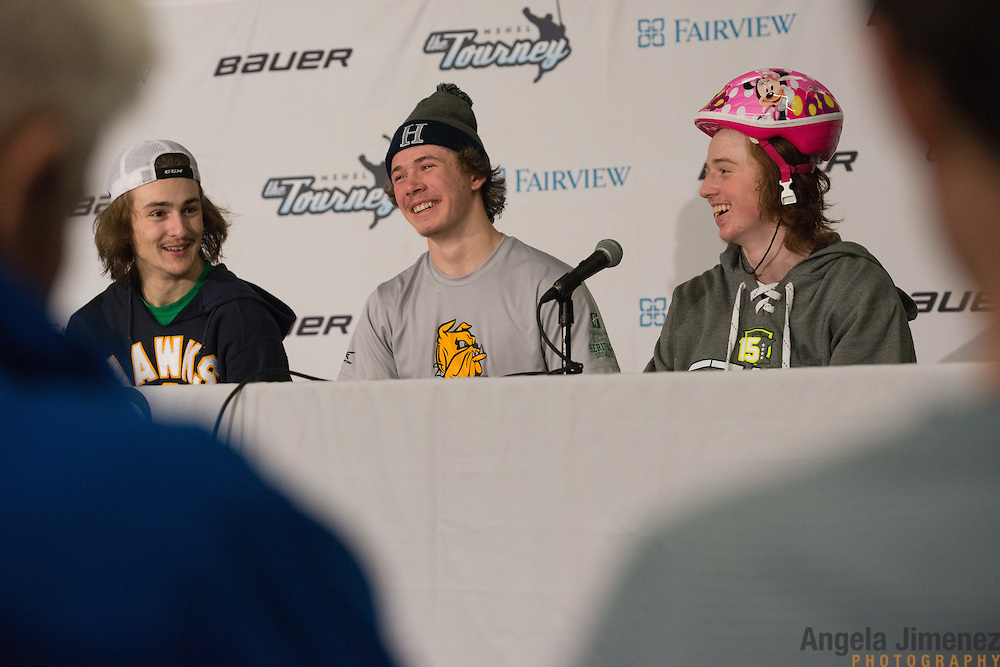 Hermantown players, from left, Nate Pionk, Cole Koepke and Jesse Jacques (wearing the Hermantown &quot;player of the game&quot; helmet) talk to reporters after the Class A semifinal game between Hermantown and St. Cloud Apollo (Hermantown won 2-0) at the Minnesota State High School League Boys' State Hockey Tournament at the Xcel Energy Center in St. Paul, Minnesota on March 6, 2015. <br />  <br /> <br /> Photo by Angela Jimenez for Minnesota Public Radio www.angelajimenezphotography.com
