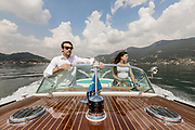 ITALY, Franciacorta area, Iseo,  Bellini Nautica . brother and sister Martina and Battista on a Riva Motorboat